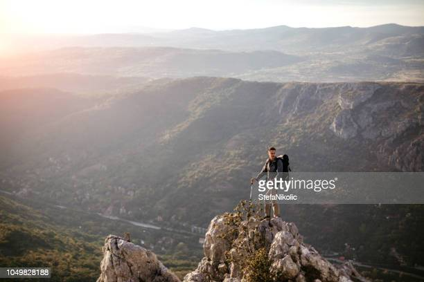 young man standing at edge in peak district - peak district national park stock pictures, royalty-free photos & images