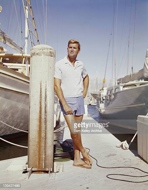 Young man standing at harbour
