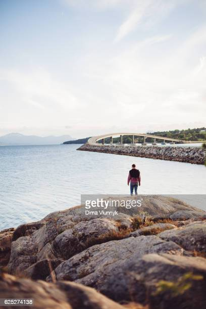 Young man standing by the ocean