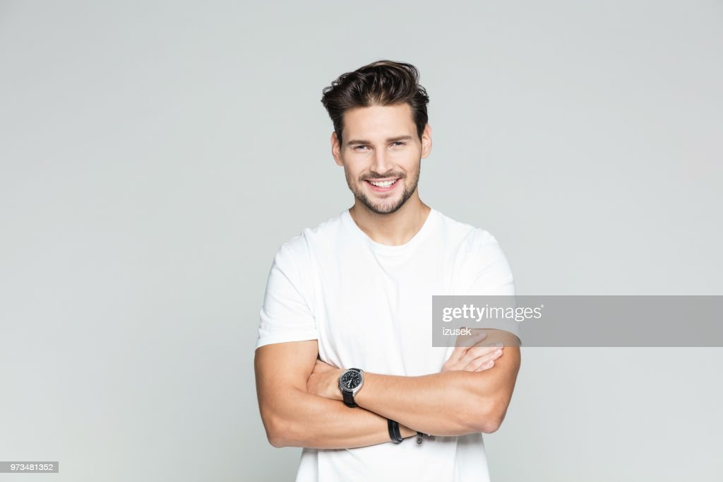 Young man standing confidently : Stock Photo