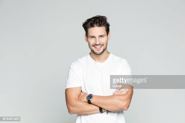 young man standing confidently - males stock pictures, royalty-free photos & images