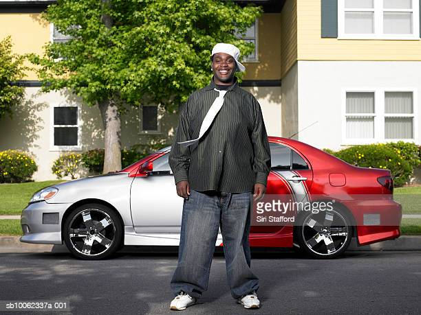 young man standing in front of customized car, portrait - pimped car stock photos and pictures