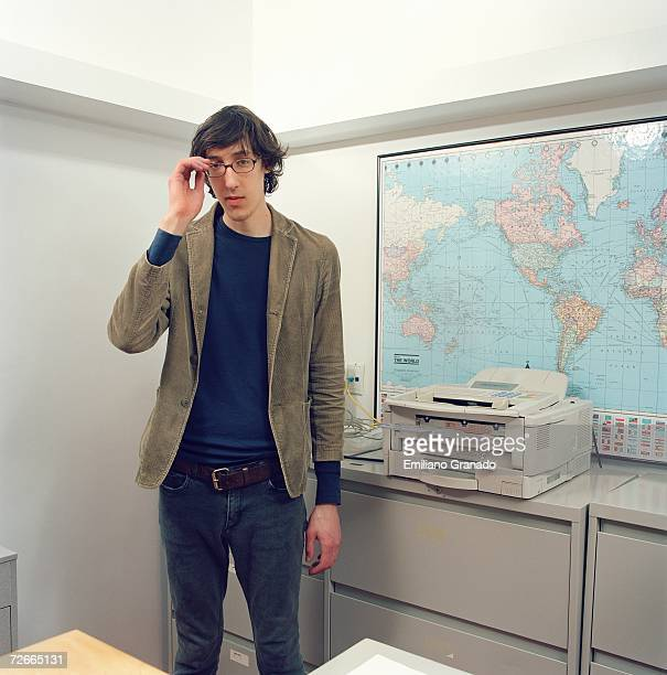 Young man standing in office