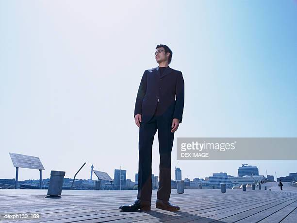 young man standing on a walkway - 男性一人 ストックフォトと画像