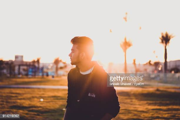 young man standing on field during sunny day - saudi stock pictures, royalty-free photos & images