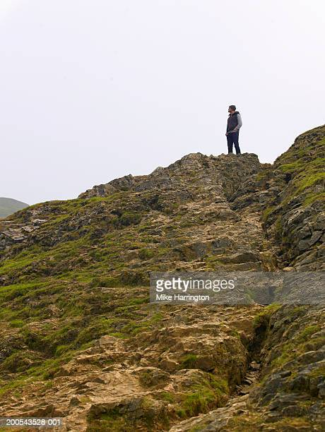 Young man standing on hill