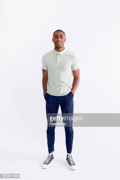 young man standing - black trousers stock pictures, royalty-free photos & images