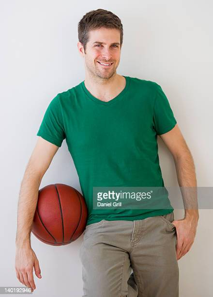 Young man standing with basket ball