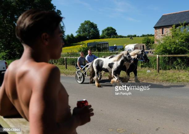 A young man stands and watches the horses on the first day of the Appleby Horse Fair on June 7 2018 in Appleby EnglandThe fair is an annual gathering...
