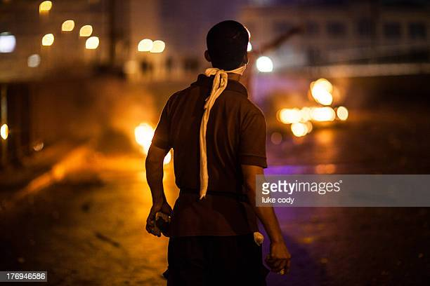 CONTENT] A young man stands defiantly as ProMorsi supporters clash with police and locals on 6th October Bridge Cairo