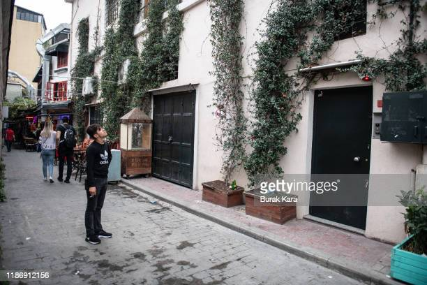 A young man stands looking at the sealed entrance of a home reportedly belonging to James Le Mesurier where his body was found dead in the early...