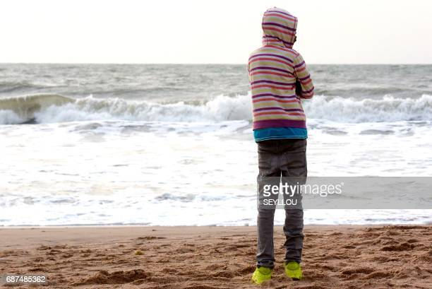 Young man stands on the beach of Kololi on April 9, 2017. For decades, The Gambia has built a reputation as a haven for tourists willing to pay for...