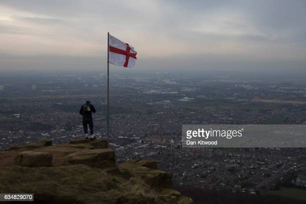 A young man stands on the top of Eston Nab in North Yorkshire which looks down at the view over the industrial area of Teeside and Middlesbrough on...
