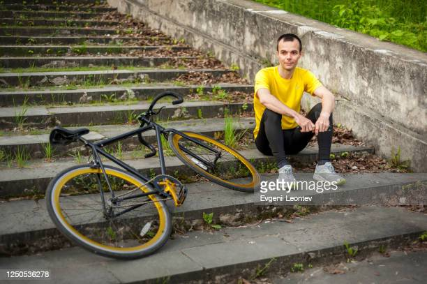 young man stopped to rest with