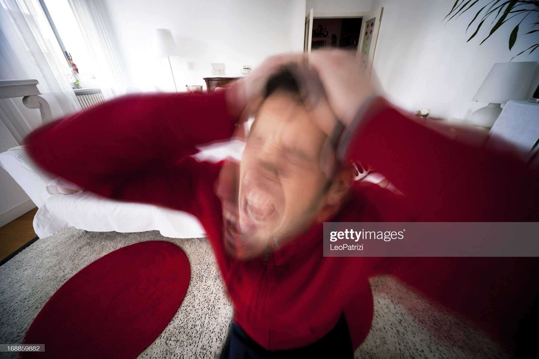 Young man stressed getting crazy at home : Stock Photo