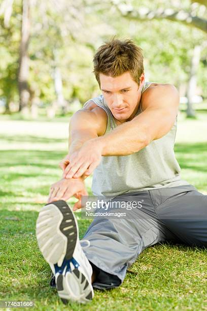 Young man stretching hand