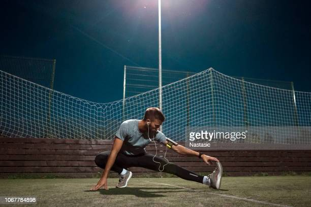 young man stretching - stability stock pictures, royalty-free photos & images