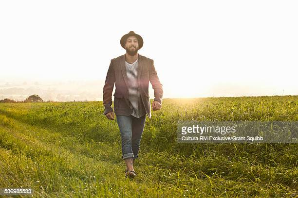 Young man strolling in fields, Dorset, England