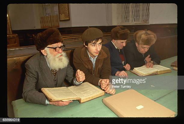 A young man studies with an old man in a synagogue on Arkhipova Street in Moscow