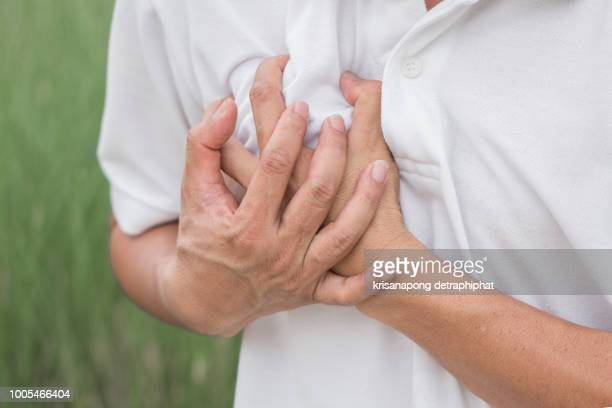 a young man suffering from heart pain - myocardium stock photos and pictures