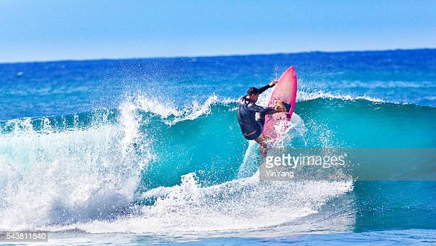 Young Man surfer Surfing in the Beach of Kauai, Hawaii