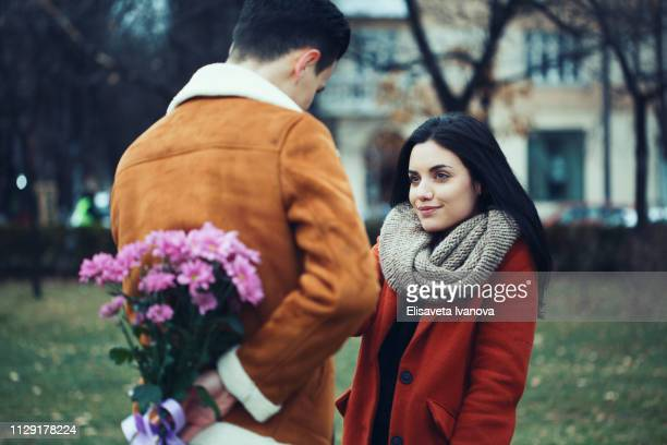 young man surprising his girlfriend on valentine's day - love at first sight stock pictures, royalty-free photos & images