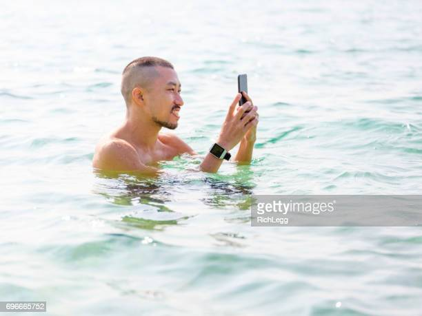 Young Man Swimming in the Okinawa Ocean
