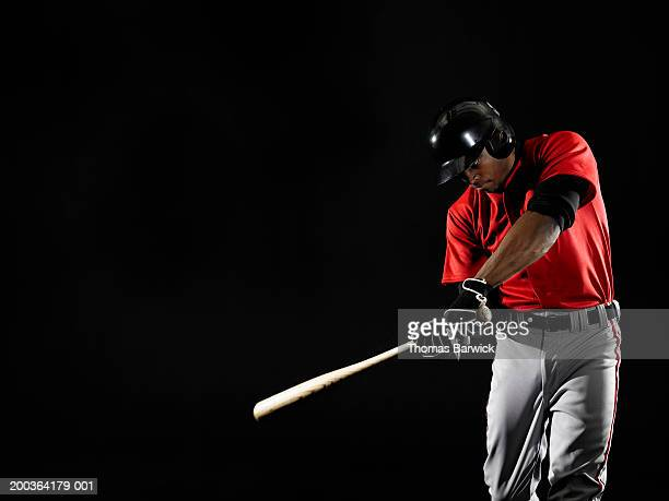 young man swinging baseball bat - baseball player stock pictures, royalty-free photos & images