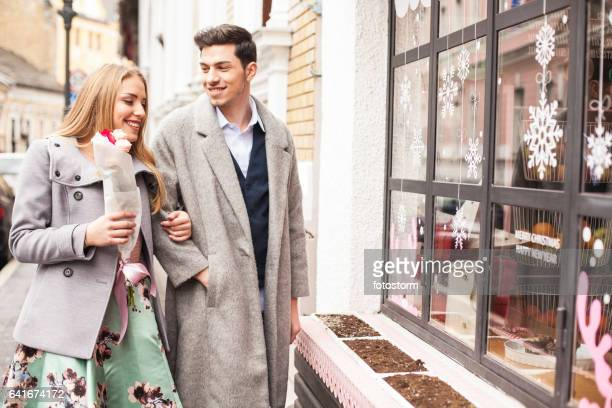 Young man take his girlfriend for a coffee and sweets