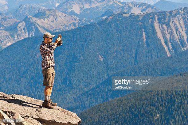 Young Man Taking a Picture With His Cell Phone