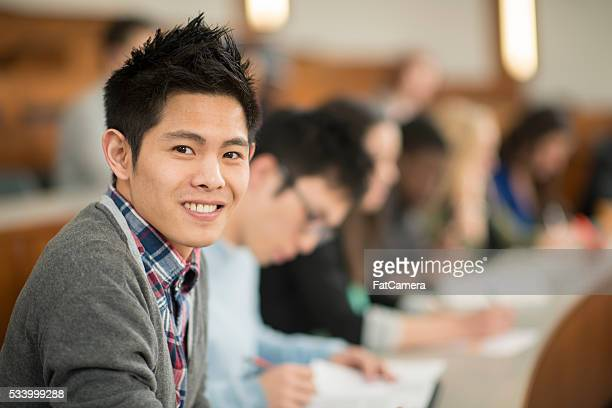 Young Man Taking a College Course