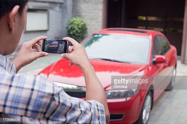 young man taking a picture of his car - car photos stock pictures, royalty-free photos & images