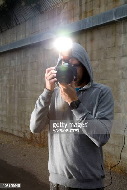 Young man taking a picture with professional camera