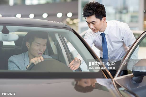 young man taking a test drive - test drive stock pictures, royalty-free photos & images