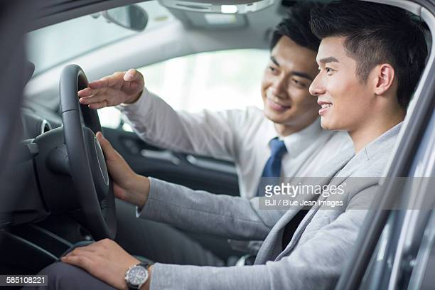 Young man taking a test drive