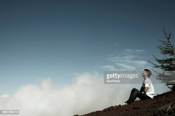 Young man taking break on mt. fuji