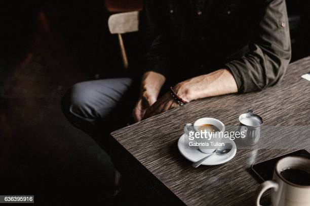 young man taking coffee at the coffee shop - espresso stock photos and pictures