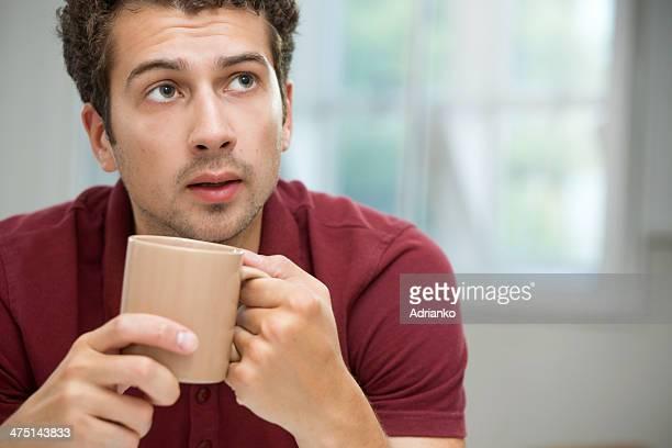 Young man taking coffee break
