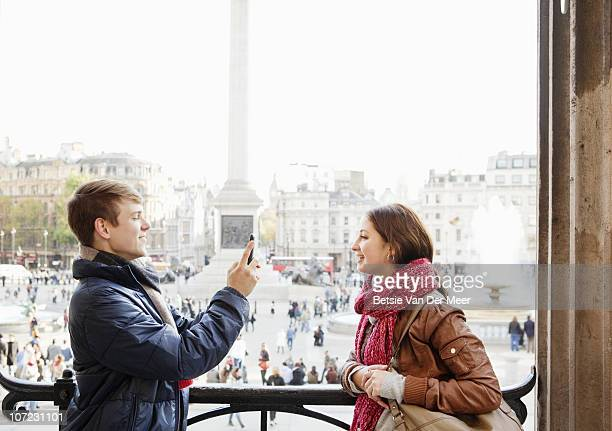 young man taking photo of girlfriend. - national gallery london stock pictures, royalty-free photos & images