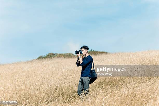 Young man taking picture