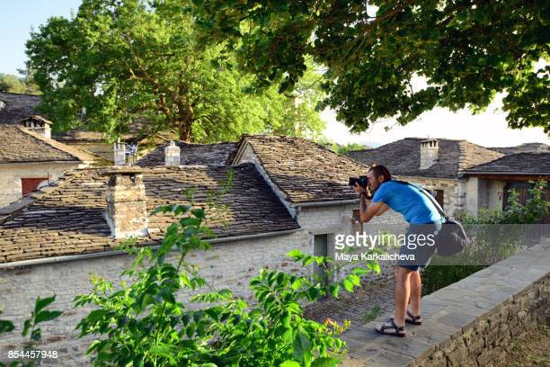 young man taking pictures in papingo village, zagoria / epirus, greece - epirus greece stock pictures, royalty-free photos & images