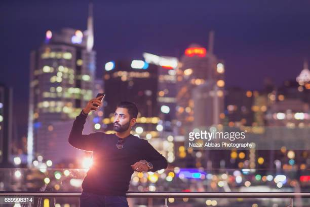 Young Man Taking Selfie In City.