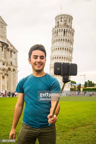 Young man taking selfie in Pisa