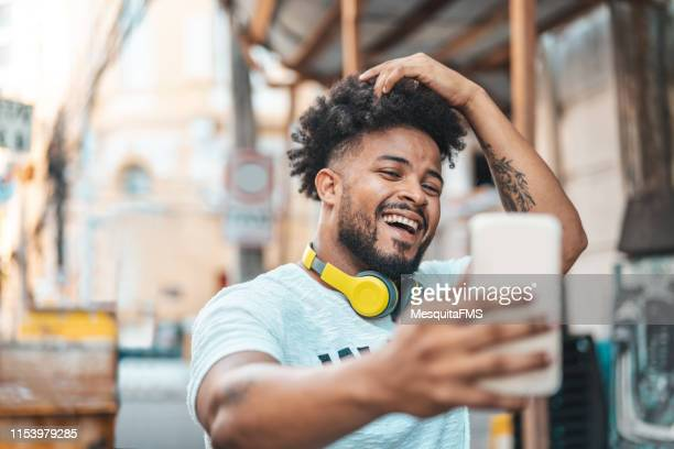 Young man taking selfie on the street