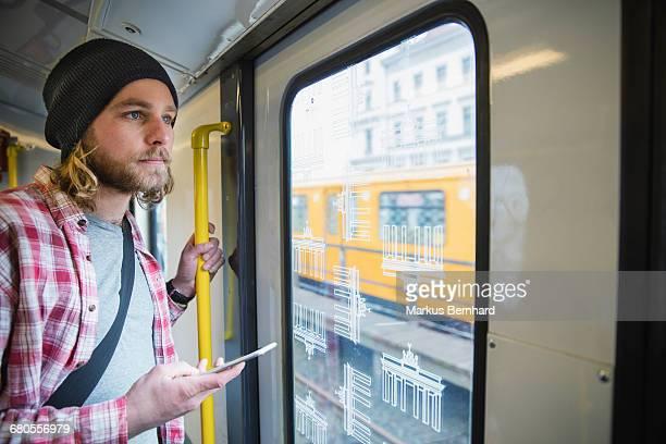 young man taking the subway - ubahn stock-fotos und bilder