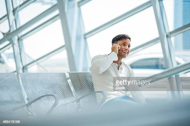 Young man talking on the phone indoors