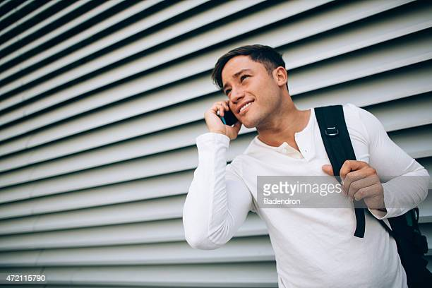 Young man talking on the telephone