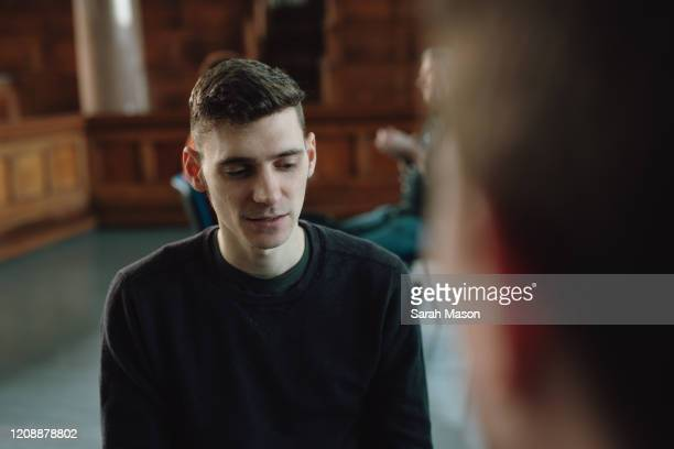 young man talking to therapist - mental health stock pictures, royalty-free photos & images