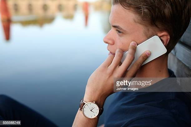 Young man talking via cell phone