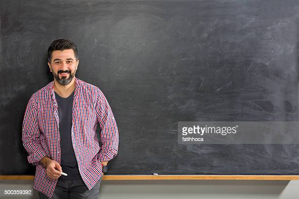 young man teacher - blackboard stock photos and pictures